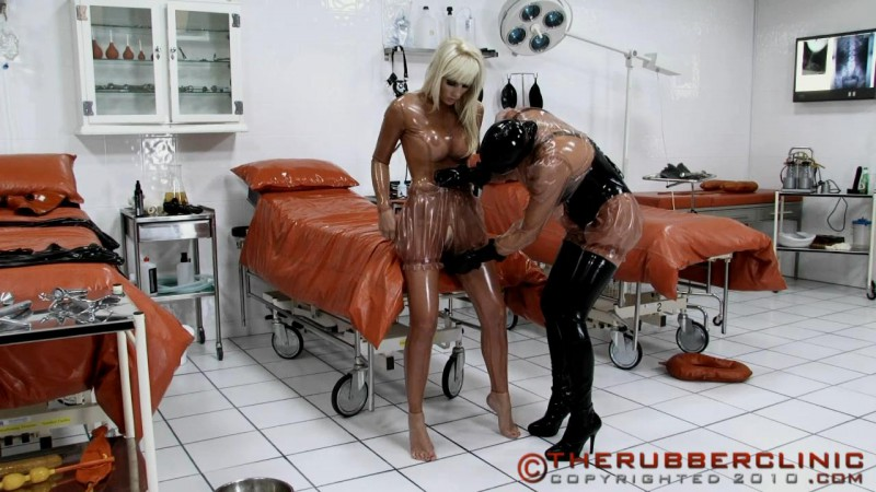 Dressed In Rubber Layers. She will be transformed in to wet Rubber layered piss slut. Therubberclinic (149 MB)