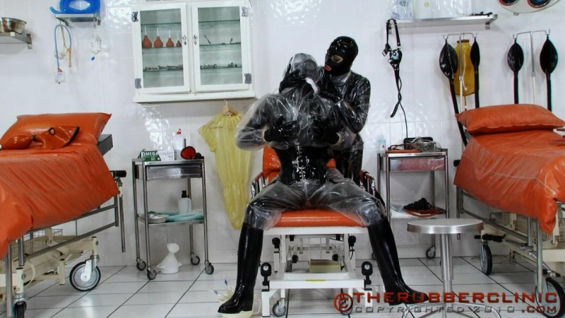 Piss Soaked Plastic Hazmat Lovers. Therubberclinic com (170 MB)